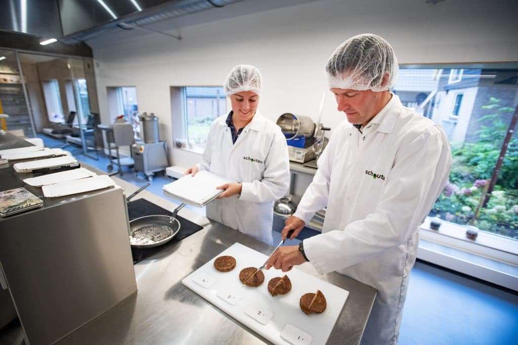 Schouten Specialist in the development of plant-based products - Research and Development, tasting vegan burgers